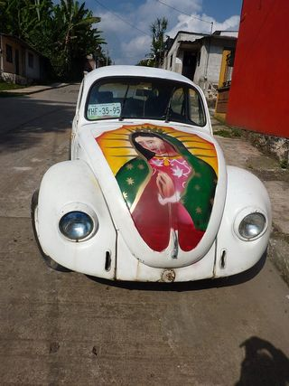 Our lady on vw hood